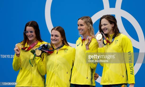 Gold medallists Australia's Kaylee McKeown , Australia's Chelsea Hodges , Australia's Emma McKeon and Australia's Cate Campbell pose with their...
