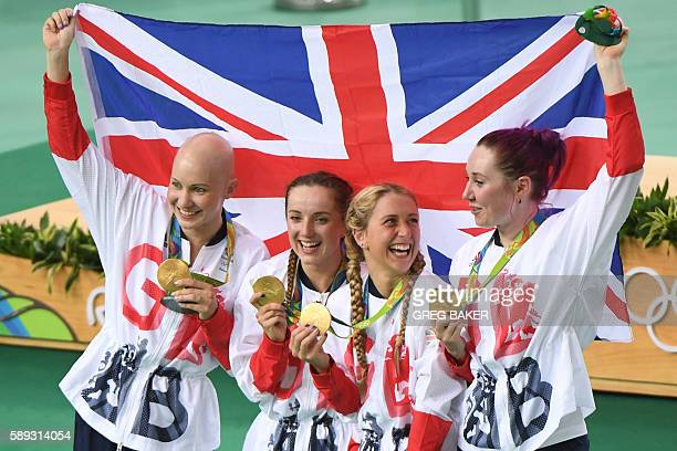 Gold medallists Britain's Joanna RowsellShand Britain's Elinor Barker Britain's Laura Trott and Britain's Katie Archibald pose with a flag and their...