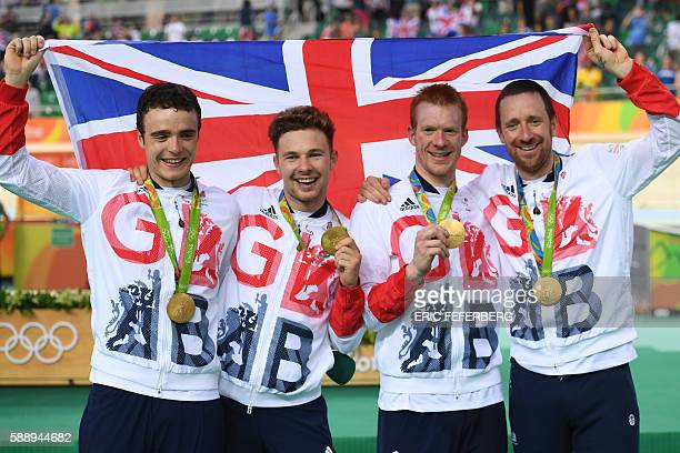 Gold medallists Britain's Steven Burke Britain's Owain Doull Britain's Edward Clancy and Britain's Bradley Wiggins pose on the podium after the men's...