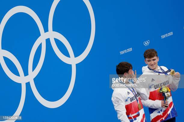 Gold medallists Britain's Thomas Daley and Britain's Matty Lee poses with their medals on the podium, after wining the men's synchronised 10m...