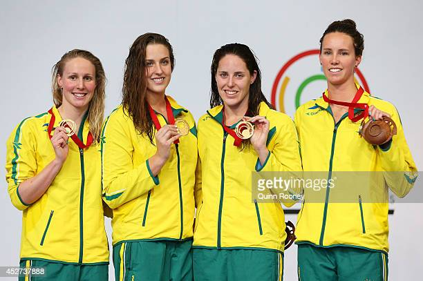 Gold medallists Bronte Barratt Brittany Elmslie Alicia Coutts and Emma McKeon of Australia pose on the podium during the medal ceremony for the...
