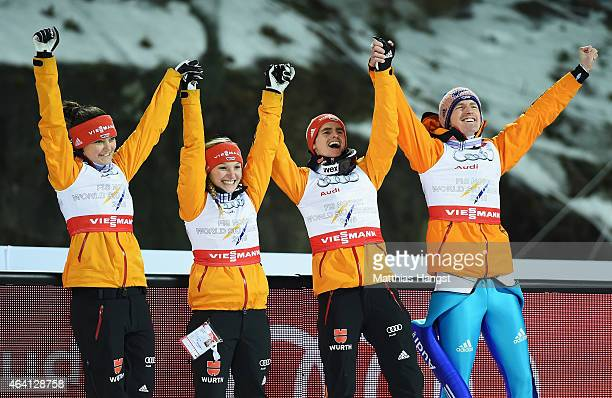Gold medallists Carina Vogt Katharina Althaus Richard Freitag and Severin Freund of Germany celebrate after the Mixed Team HS100 Normal Hill Ski...