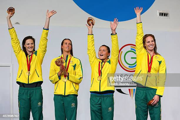 Gold medallists Cate Campbell Emma McKeon Lorna Tonks and Emily Seebohm of Australia pose during the medal ceremony for the Women's 4 x 100m Medley...
