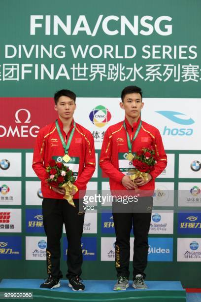 Gold medallists Chen Aisen and Yang Hao of China pose during the medal ceremony for the Men's 10m Synchro Platform Final during day one of the...