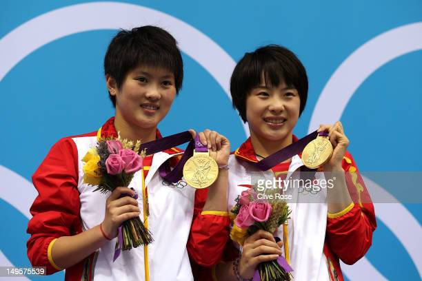 Gold Medallists Chen Roulin and Hao Wang and of China pose on the podium during the medal ceremony for the Women's Synchronised 10m Platform Diving...
