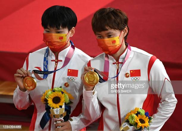 Gold medallists China's Bao Shanju and China's Zhong Tianshi pose with their medals on the podium after the women's track cycling team sprint finals...