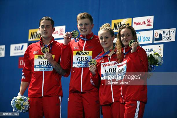 Gold medallists Chris Walker-Hebborn, Adam Peaty, Siobhan-Marie O'Connor and Fran Halsall of Great Britain pose during the medal ceremony for the...