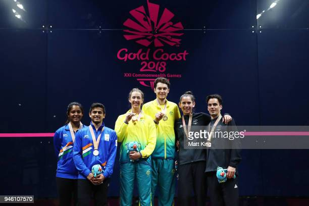 Gold medallists Donna Urquhart and Cameron Pilley of Australia silver medallists Joelle King and Paul Coll of New Zealand and bronze medallists...