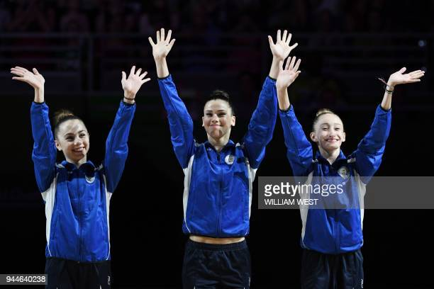 Gold medallists Eleni Ellina Diamanto Evripidou and Viktoria Skittidi of Cyprus celebrate on the podium after the rhythmic gymnastics team final...
