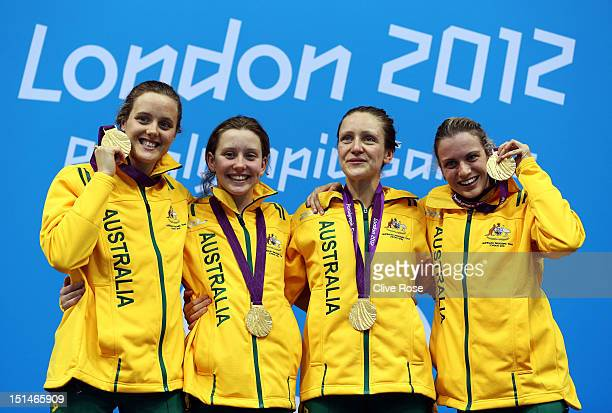 Gold medallists Ellie Cole Katherine Downie Annabelle Williams and Jacqueline Freney of Australia pose on the podium during the medal ceremony for...