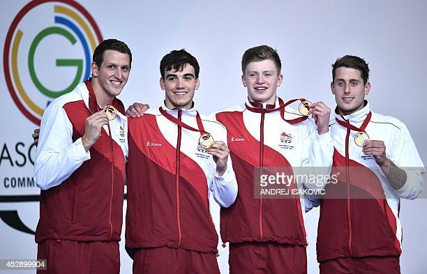 Gold medallists England's Chris WalkerHebborn England's Adam Peaty England's Adam Barrett and England's Adam Brown pose during the Men's 4 x 100m...