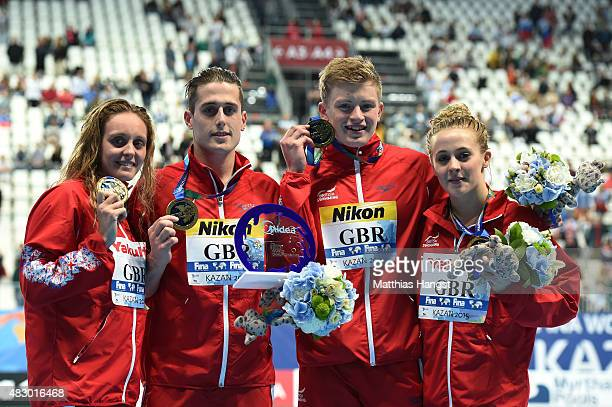 Gold medallists Fran Halsall Chris WalkerHebborn Adam Peaty and SiobhanMarie O'Connor of Great Britain pose during the medal ceremony for the Mixed...