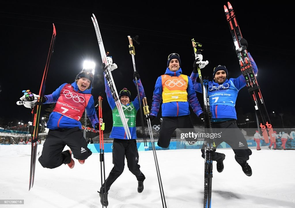 TOPSHOT - (From L) Gold medallists France's Marie Dorin Habert, France's Anais Bescond, France's Simon Desthieux, and France's Martin Fourcade celebrate during the victory ceremony in the mixed relay biathlon event during the Pyeongchang 2018 Winter Olympic Games on February 20, 2018, in Pyeongchang. /