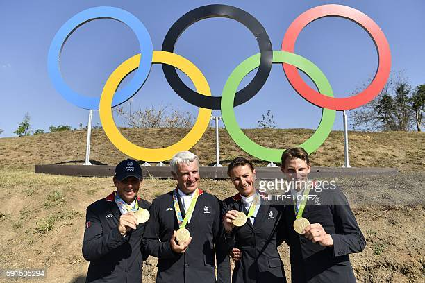Gold medallists, France's riders Philippe Rozier , Roger Yves Bost, Penelope Leprevost and Kevin Staut, pose with their medals in front of the...
