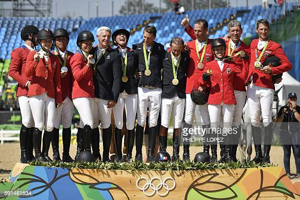 Gold medallists, France's riders Roger Yves Bost, Penelope Leprevost, Philippe Rozier, Kevin Staut, silver medallists , USA's riders Lucy Davis, Kent...
