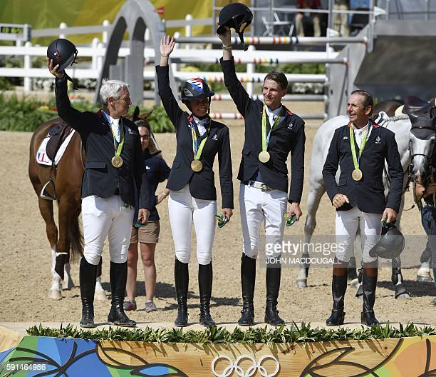 Gold medallists, France's riders Roger Yves Bost, Penelope Leprevost, Philippe Rozier, Kevin Staut, pose during the podium ceremony of the jumping...