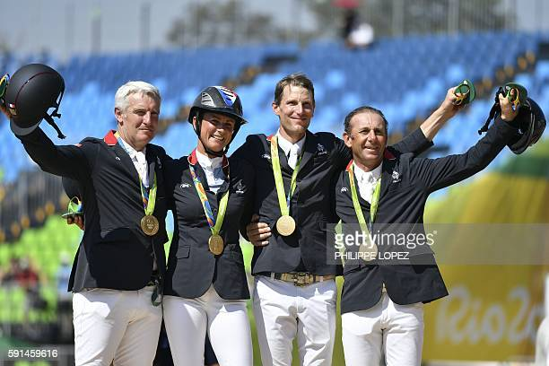 Gold medallists, France's riders Roger-Yves Bost, Penelope Leprevost, Philippe Rozier, Kevin Staut, pose during the podium ceremony of the jumping...
