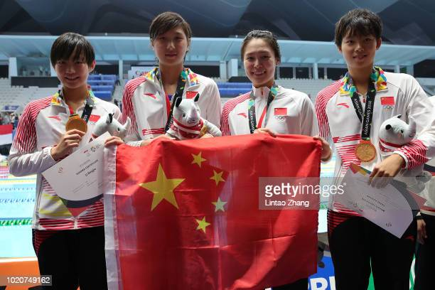 Gold medallists from China celebrate during the victory ceremony for the women's 4x200m freestyle relay swimming event on day three of the Asian...