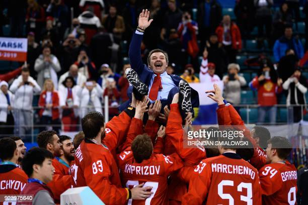 Gold medallists from the Olympic Athletes from Russia carry their head coach Oleg Znarok after the medal ceremony after the men's gold medal ice...