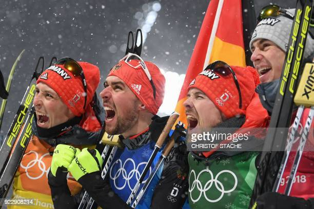 Gold medallists Germany's Eric Frenzel Germany's Johannes Rydzek Germany's Fabian Riessle and Germany's Vinzenz Geiger celebrate after the nordic...