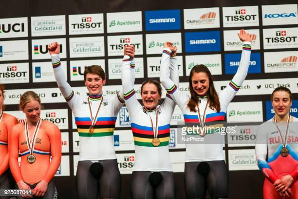Gold medallists Germany's Miriam Welte Kristina Vogel and Pauline Sophie Grabosch pose on the podium after their victory in the women's team sprint...