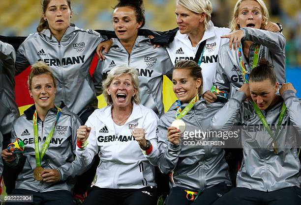 Gold medallists Germany's players and coach Silvia Neid pose for photographers following the women's football medal ceremony of the Rio 2016 Olympic...