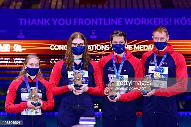 Gold medallists Great Britain pose during the podium ceremony the final of the Mixed 4x100m Freestyle Relay Swimming event during the LEN European...