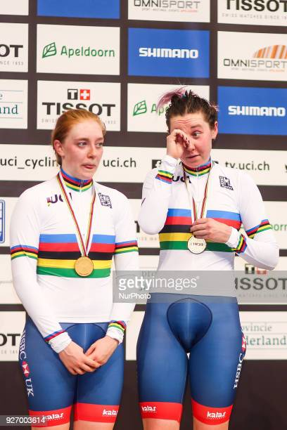 Gold medallists Great Britain's Emily Nelson and Katie Archibald pose on the podium after taking part in the women's madison final during the UCI...