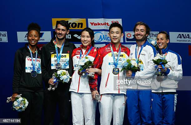 Gold medallists Han Wang and Hao Yang of China pose with silver medallists Jennifer Abel and Francois ImbeauDulac of Canada and bronze medallists...
