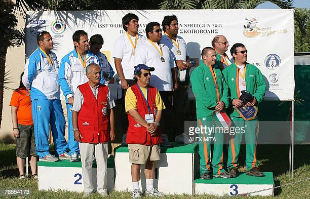Gold medallists in the men's trap team event Kuwait are flanked on the podium by the silver medallists of Italy and the bronze medallists from the...