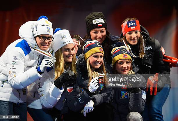 Gold medallists Ingvild Flugstad Oestberg and Maiken Caspersen Falla of Norway pose with silver medallists Ida Ingemarsdotter and Stina Nilsson of...
