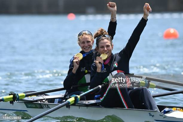 Gold medallists Italy's Valentina Rodini and Federica Cesarini pose in their boat following the lightweight women's double sculls final during the...