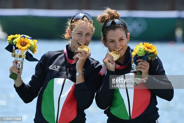 Gold medallists Italy's Valentina Rodini and Federica Cesarini pose on the podium following the lightweight women's double sculls final during the...