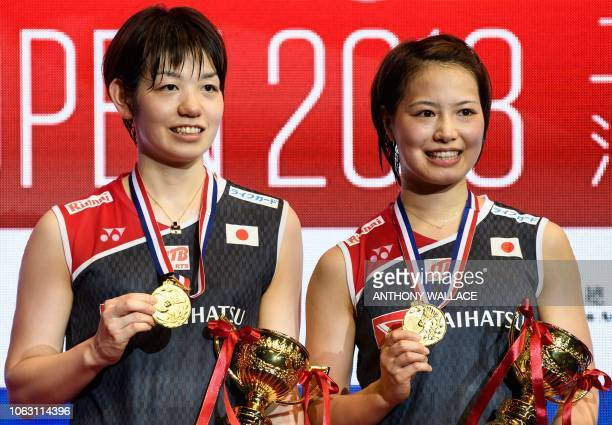 Gold medallists Japan's Yuki Fukushima and Sayaka Hirota pose after winning their women's doubles final against South Korea's Lee Sohee and Shin...