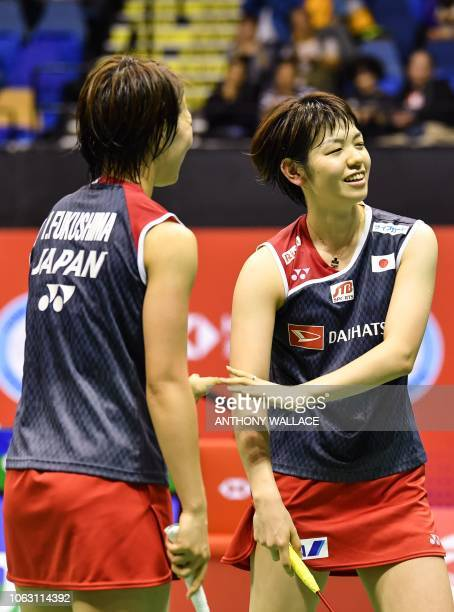 Gold medallists Japan's Yuki Fukushima and Sayaka Hirota react after winning a point in their women's doubles final against South Korea's Lee Sohee...