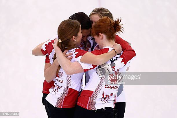 Gold medallists Jennifer Jones Kaitlyn Lawes Jill Officer and Dawn McEwen of Canada celebrate after the Gold medal match between Sweden and Canada on...