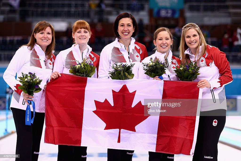 Gold medallists Jennifer Jones (R), Kaitlyn Lawes (2nd R), Jill Officer (C), Dawn McEwen (2nd L) and Kirsten Wall (L) of Canada celebrate during the flower ceremony for the Gold medal match between Sweden and Canada on day 13 of the Sochi 2014 Winter Olympics at Ice Cube Curling Center on February 20, 2014 in Sochi, Russia.