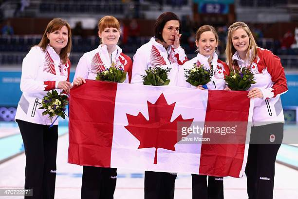Gold medallists Jennifer Jones Kaitlyn Lawes Jill Officer Dawn McEwen and Kirsten Wall of Canada celebrate during the flower ceremony for the Gold...