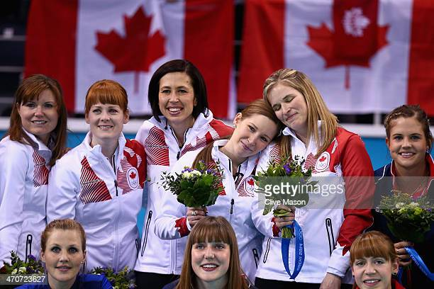 Gold medallists Jennifer Jones , Kaitlyn Lawes , Jill Officer , Dawn McEwen and Kirsten Wall of Canada celebrate during the flower ceremony for the...