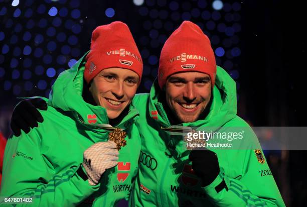 Gold Medallists Johannes Rydzek and Eric Frenzel of Germany celebrate during the medal ceremony after the Men's Nordic Combined HS130 Ski Jumping / 2...