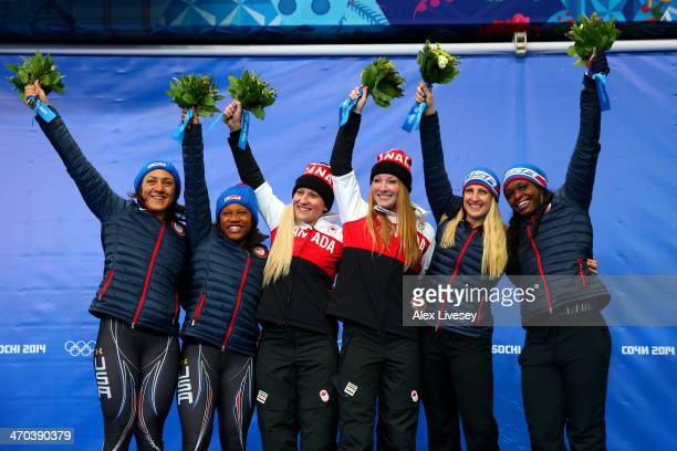 Gold medallists Kaillie Humphries and Heather Moyse of Canada team 1 pose on the podium with silver medallists Elana Meyers and Lauryn Williams of...
