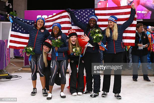 Gold medallists Kaillie Humphries and Heather Moyse of Canada team 1 pose with silver medallists Elana Meyers and Lauryn Williams of the United...