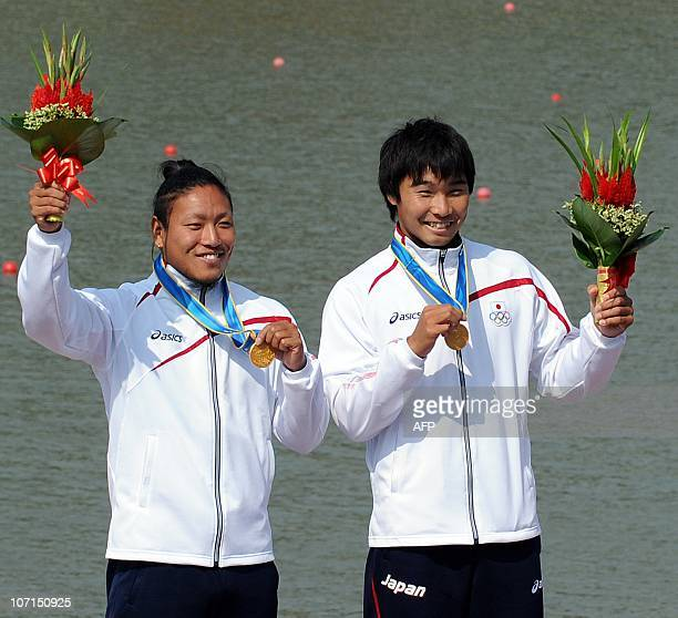 Gold medallists Keiji Mizumoto and Momotaro Matsushita of Japan pose together on the podium during the medals ceremony for the men's kayak double...