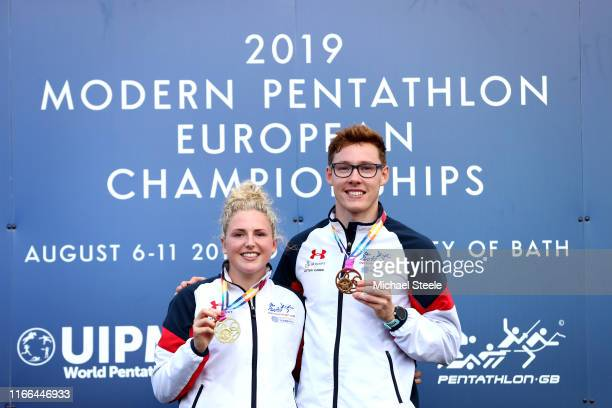 Gold medallists Kerenza Bryson and Myles Pillage of Great Britain pose for a photo with their medals at the podium following their victory in the...