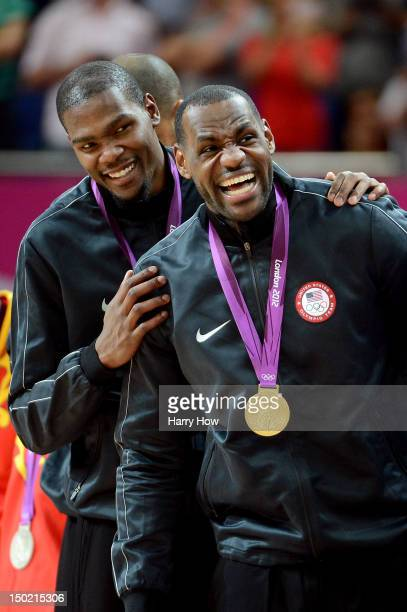 Gold medallists Kevin Durant of the United States and LeBron James of the United States celebrate on the podium during the medal ceremony for the...
