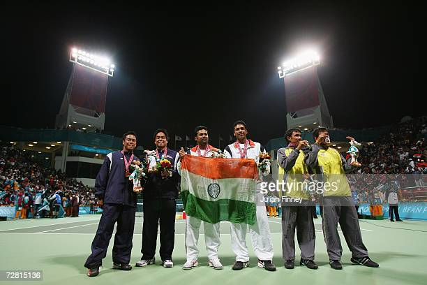 Gold medallists Leander Paes and Mahesh Bhupathi of India pose with silver medallists Sanchai Ratiwatana and Sonchat Ratiwatana of Thailand and...