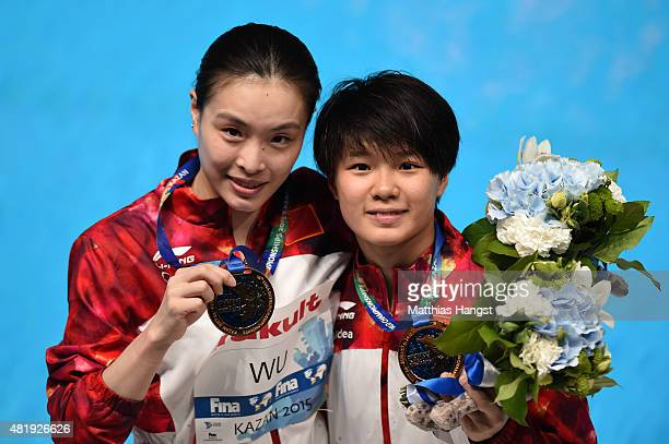 Gold medallists Minxia Wu and Tingmao Shi of China pose during the medal ceremony for the Women's 3m Springboard Synchronised Diving Final on day one...