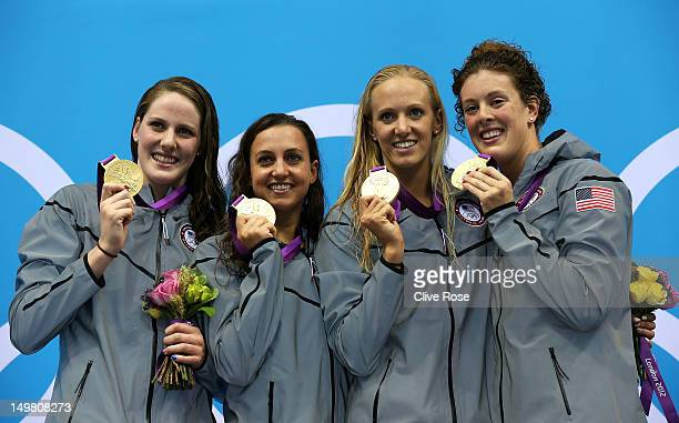 Gold medallists Missy Franklin Rebecca Soni Dana Volmer and Allison Schmitt of the United States pose on the podium during the medal ceremony for the...