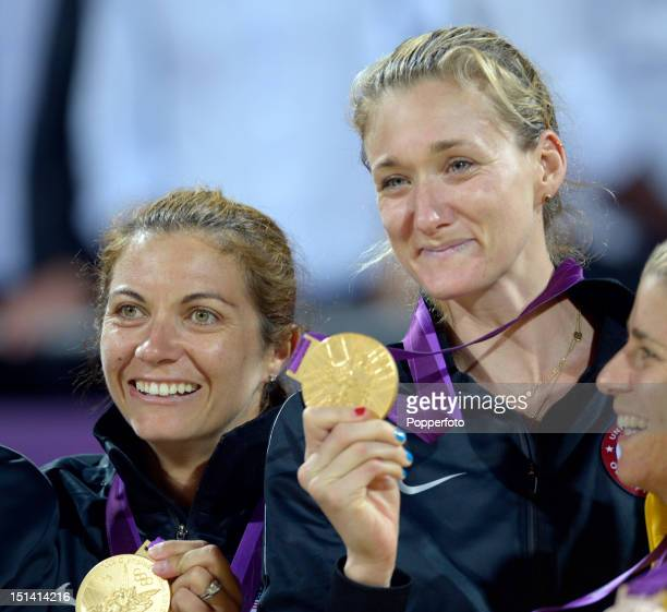 Gold medallists Misty May-Treanor and Kerri Walsh Jennings of the United States celebrate on the podium during the medal ceremony for the Women's...