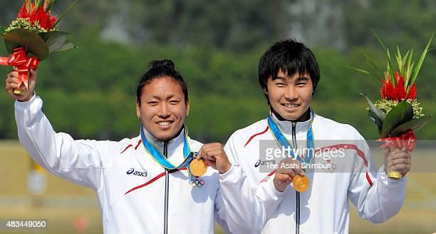 Gold medallists Momotaro Matsushita and Keiji Mizumoto of Japan pose on the podium at the medal ceremony for the Canoe Sprint Men's Kayak Pair 200m...